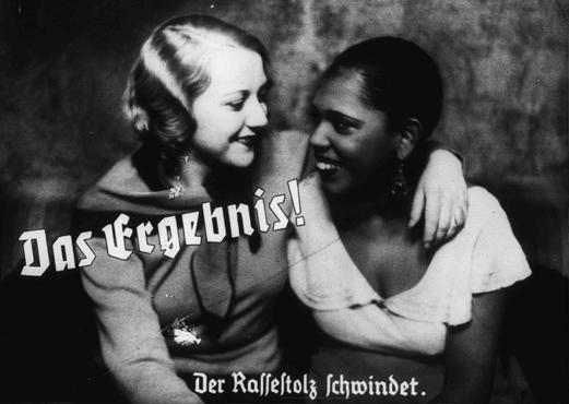 "Nazi propaganda photo depicts friendship between an ""Aryan"" and a black woman. The caption states: ""The result! A loss of racial pride."" Germany, prewar."