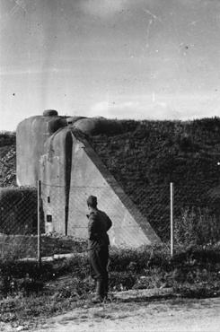 After the defeat of France, a German soldier examines French fortifications along the Maginot Line, a series of fortifications along the border with Germany. France, 1940.