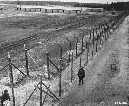 On May 2, 1945, the 8th Infantry Division and the 82nd Airborne Division encountered the Wöbbelin concentration camp. Here, American soldiers patrol the perimeter of the camp. Germany, May 4-May 10, 1945.