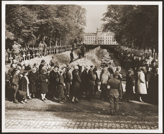 German civilians from Ludwigslust file past the corpses and graves of 200 prisoners from the nearby concentration camp of Wöbbelin. The US Army ordered the townspeople to bury the corpses on the palace grounds of the Archduke of Mecklenburg. Germany, May 7, 1945.