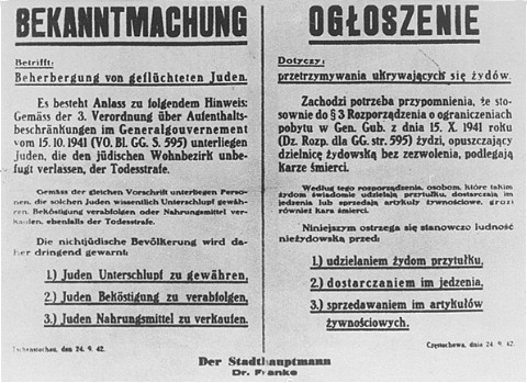 A Nazi decree issued in October 1941, in German and Polish, warns that Jews leaving the ghetto, or Poles who aid them, will be executed. Czestochowa, Poland.