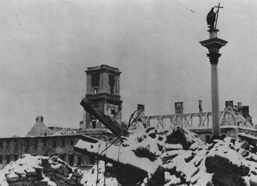 The Sigismund Monument stands amid rubble in the Polish capital after Germany's Blitzkrieg assault. Warsaw, Poland, 1939.