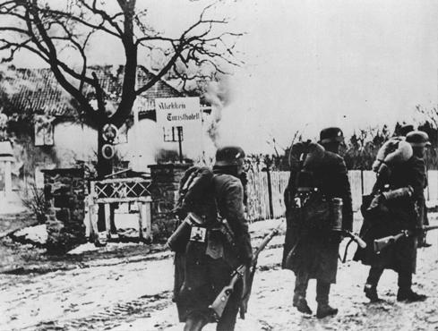 German troops pass through a village during the invasion of Norway. Norway, wartime.