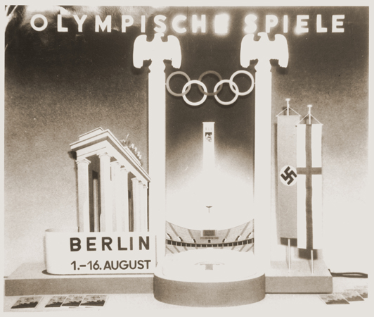A display advertising the 11th Summer Olympic Games which were held in Berlin, Germany, 1936.