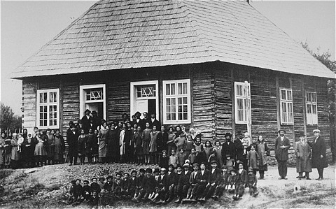 Prewar group portrait in front of a synagogue in the Transylvanian town of Sighet.