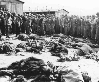 General Dwight D. Eisenhower (center), Supreme Allied Commander, views the corpses of inmates who perished at the Ohrdruf camp. Ohrdruf, Germany, April 12, 1945.