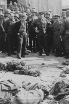 General Dwight D. Eisenhower (center, right) views the corpses of victims of the Ohrdruf camp. Germany, April 12, 1945.