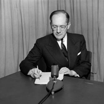"Raphael Lemkin prepares for a talk on UN radio, probably between 1947 and 1951. Lemkin coined the term ""genocide"" in 1944."