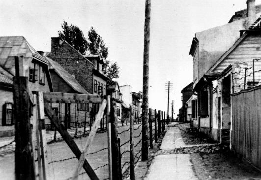 Entrance gate to the Riga ghetto. This photograph was taken from outside the ghetto fence. Riga, Latvia, 1941-1943.