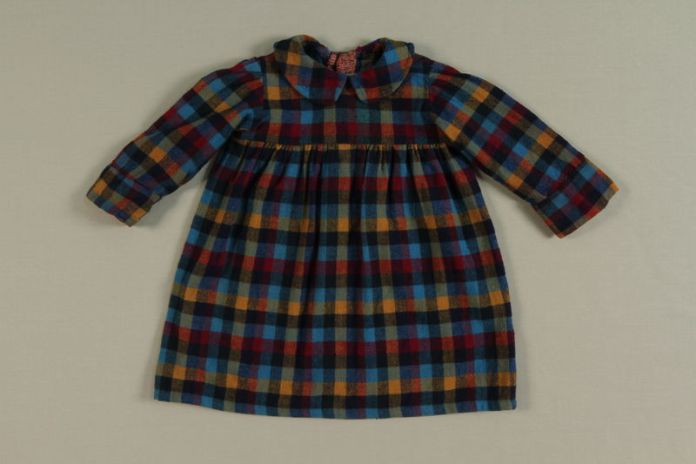 A dress worn by hidden child in Baarn, the Netherlands. The dress was donated to the United States Holocaust Memorial Museum in 2002 by Vera Waisvisz-Reiss.