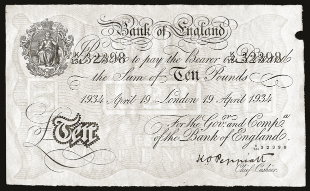 A counterfeit British bank note produced by Jewish forced laborers employed in Operation Bernhard at the Sachsenhausen concentration camp. Under an order issued by SS chief Heinrich Himmler in 1942, Operation Bernhard initially aimed to produce large quantities of counterfeit British bank notes, flood the British currency market, and trigger a financial crisis.