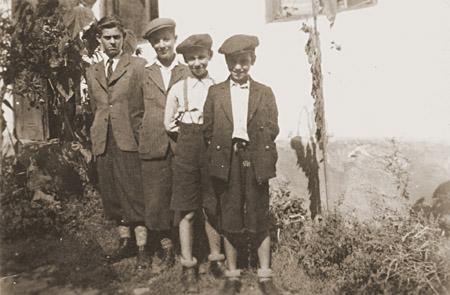 The Weinberger children pose for a photograph. Munkacs, 1940.