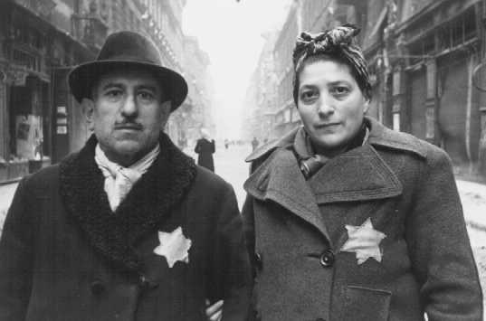 Hungarian Jews with yellow stars, at the time of the liberation of the Budapest ghetto. Hungary, January 1945.