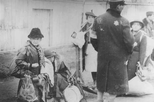 Jewish deportees from Luxembourg, Austria, and Czechoslovakia during deportation from the Lodz ghetto to the Chelmno killing center. Lodz, Poland, 1942.