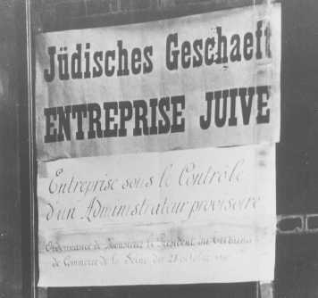 """Aryanization"" in France: this shop, belonging to Jews, has been given to a non-Jewish ""temporary administrator."" Paris, April 1942."