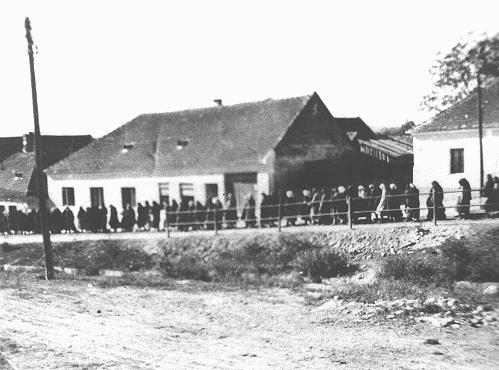 Romani (Gypsy) women march to work in the Lackenbach internment camp. Lackenbach, Austria, 1940-1941.