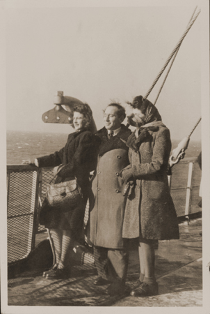 Rozalia (Krysia Laks) Lerman, Miles Lerman, and Regina Laks stand on the deck of the Marine Perch while en route to the United States. January 1947.