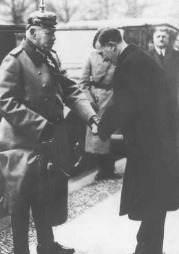 Adolf Hitler, the newly appointed chancellor, greets German president Paul von Hindenburg. Berlin, Germany, January 30, 1933.