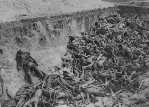 A mass grave soon after camp liberation. Bergen-Belsen, Germany, May 1945.