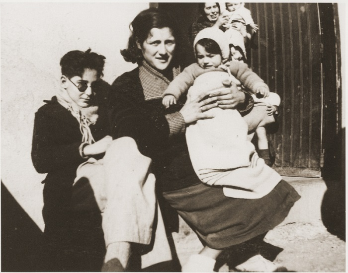 "In 1939, some 500,000 Spanish Republicans fled to France, where many, including this family, were interned in camps. When World War II broke out, these internment camps housed ""enemy aliens,""  including German-Jewish refugees and Nazi political opponents. Rivesaltes, France, ca. 1941,"