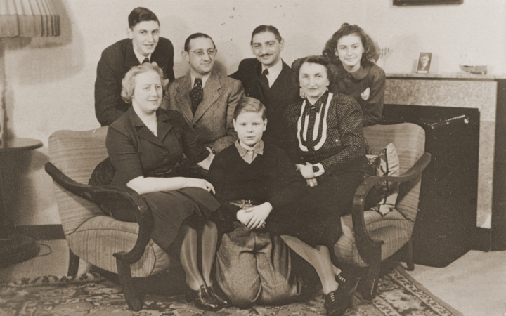 The Jacobsthal family poses with an aunt and uncle who are visiting their home in Amsterdam before emigrating to Chile.  Amsterdam, The Netherlands, February 1938.
