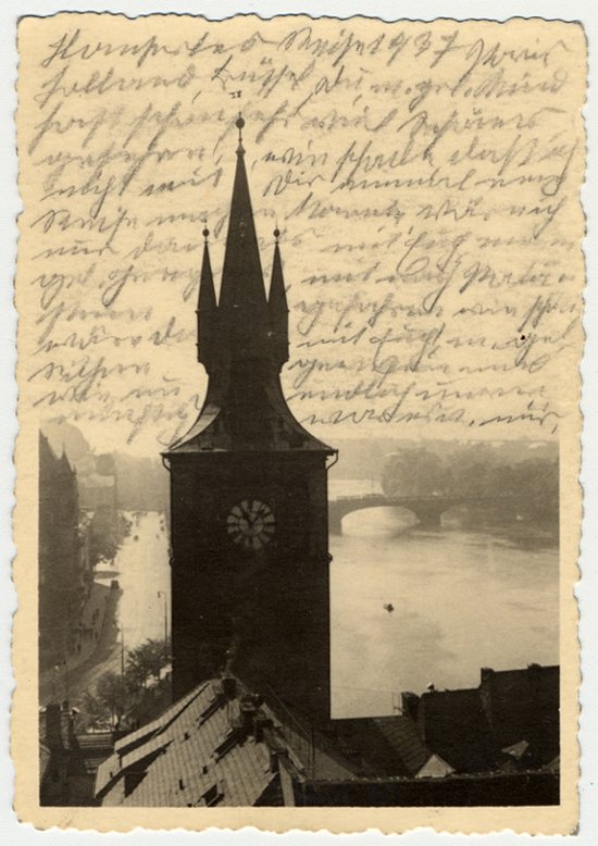 Photograph of the water tower of the Old Town Mills in Prague. After her deportation to the Theresienstadt ghetto in Czechoslovakia, Helene Reik yearned to record what was happening to her. This photograph was sent to Helene, who used it as paper for her diary in Theresienstadt. Helene's makeshift diary offers wistful memories of her husband and parents who died before the war, loving thoughts of her family who had left Europe in 1939, and a firsthand account of the illness and hospitalization that ultimately led to her death. Because resources were scarce in the Theresienstadt ghetto, Helene recorded her thoughts, recollections, and diary entries in the margins and on the backs of family pictures that she had brought with her, as well as postcards and letters she received while in the ghetto.