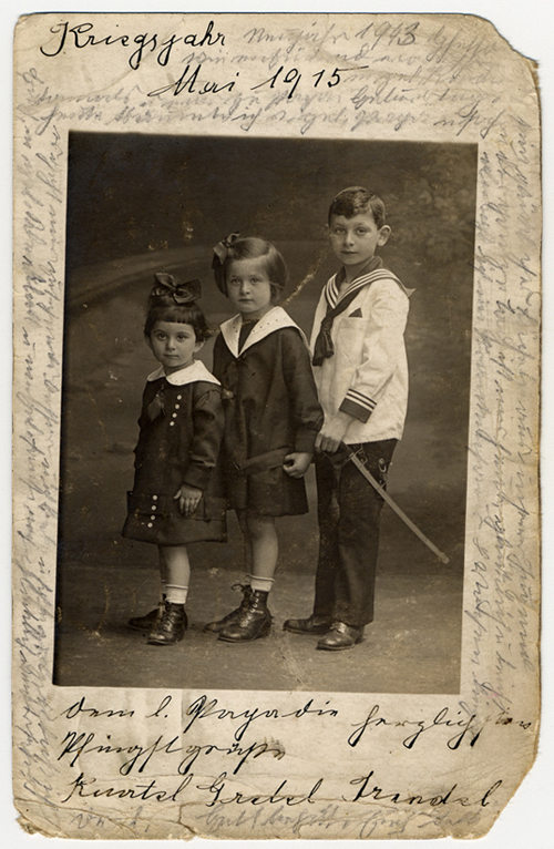 Photograph taken in May 1915 of Helene Reik's children. After her deportation to the Theresienstadt ghetto in Czechoslovakia, Helene yearned to record what was happening to her. This photograph was sent to Helene, who used it as paper for her diary in Theresienstadt. Helene's makeshift diary offers wistful memories of her husband and parents who died before the war, loving thoughts of her family who had left Europe in 1939, and a firsthand account of the illness and hospitalization that ultimately led to her death. Because resources were scarce in the Theresienstadt ghetto, Helene recorded her thoughts, recollections, and diary entries in the margins and on the backs of family pictures that she had brought with her, as well as postcards and letters she received while in the ghetto.