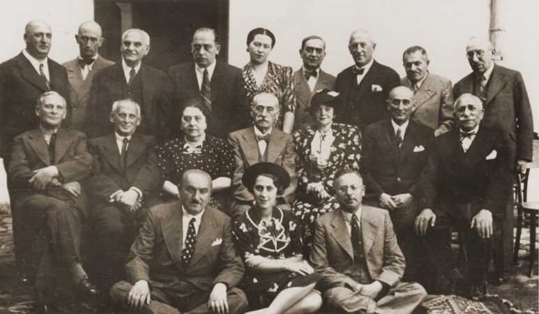 Members of the mostly Jewish Masonic lodge in Czernowitz celebrate the 70th birthday of Dr. Isidor Gold (center). Women attended lodge meetings on special occasions such as this one. Chernovtsy, Romania, August 1937,