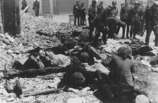 German soldiers capture Jews hiding in a bunker during the Warsaw ghetto uprising. Warsaw, Poland, April-May 1943.