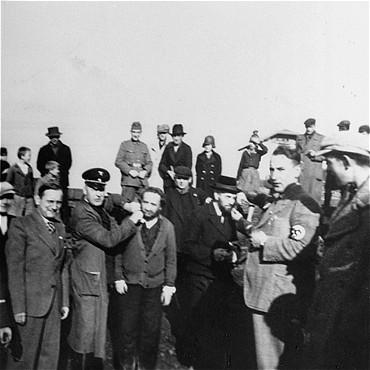 Germans humiliate religious Jews in Tarnow. Poland, 1940.