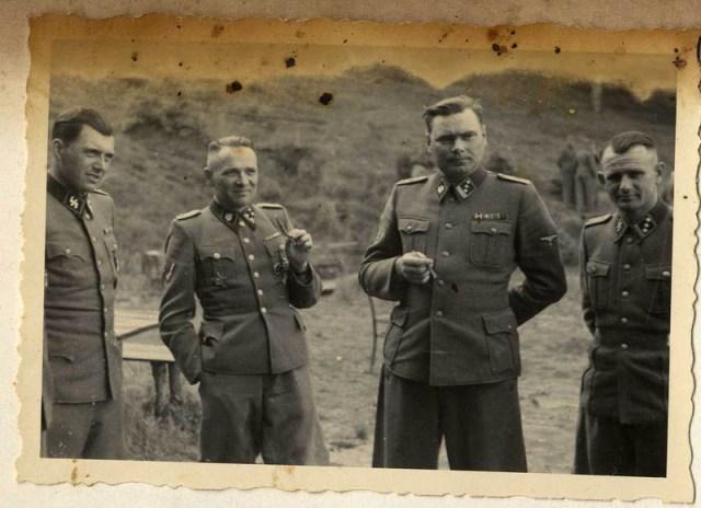 Left to right: Dr. Josef Mengele, Rudolf Höss, Josef Kramer, and an unidentified officer.