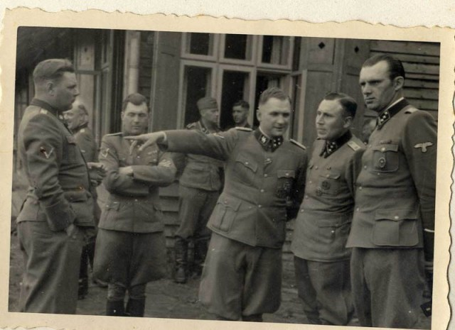 Left to right: Josef Kramer, Dr. Josef Mengele, Richard Baer, Karl Höcker, and an unidentified officer.