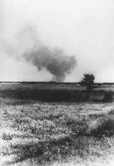 Distant view of smoke from the Treblinka killing center, set on fire by prisoners during a revolt. This scene was photographed by a railway worker. Treblinka, Poland, August 2, 1943.