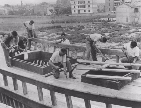 "Jewish youth at the ""HaRishona"" (The First) Zionist training center construct a fishing boat. They are preparing for emigration to Palestine. Fano, Italy, 1946."