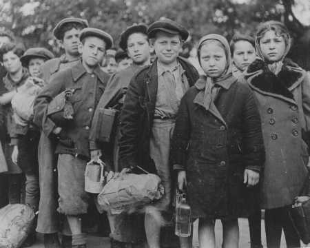 Polish Jewish children, part of Brihah—the flight from Europe—en route to the Allied occupation zones in Germany and Austria. The children wait at a relief station in Prague. Czechoslovakia, 1946.