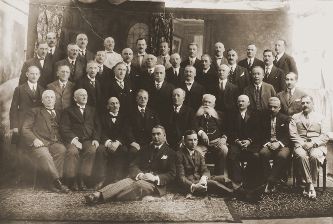 Group portrait of members of the Freemasons Lodge of Chernovtsy, Bukovina, approximately 75 percent of whom were Jewish. The members were mainly intellectuals and leaders in business and local government. Among those pictured are Dr. Max Ennis (top row, third from the left); pharmacist, Dr. Abraham Guttman (top row, far right); an official in the revenue service, Dr. Max Gottfried (second row from the top, sixth from the left); and the judge, Dr. Jacob Rubel (third row from the top, far left). Chernovtsy, Romania, 1920 - 1925.