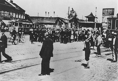 Jewish residents of the Szeged ghetto assemble for deportation. Szeged, Hungary, June 1944.