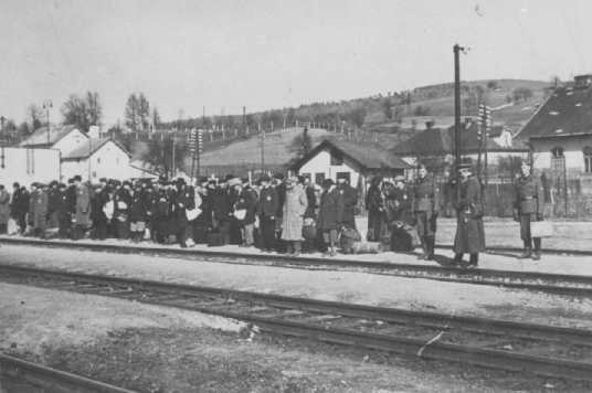Jews at the railroad station before deportation. Puchov, Czechoslovakia, March 1942.