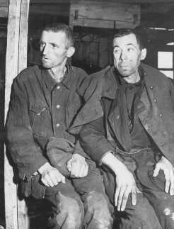 Two malnourished Soviet prisoners of war, survivors of the Hemer prisoner of war camp in western Germany. More than three million Soviet prisoners of war died in German custody, mostly from malnutrition and exposure. Hemer, Germany, April 29, 1945.