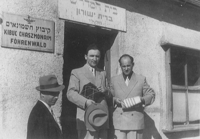 Meyer Lifschitz and a friend leave the synagogue in the Foehrenwald displaced persons camp. Foehrenwald, Germany, 1945.