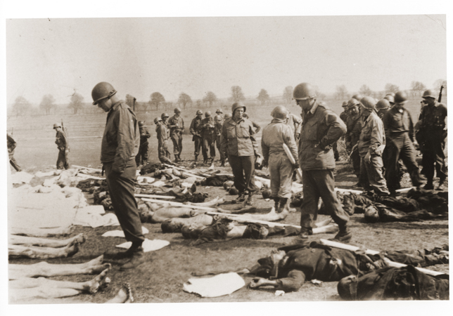 American soldiers view the bodies of prisoners laid out in rows in an open field at Ohrdruf, a subcamp of Buchenwald in Germany. The 4th Armored and 89th Infantry Divisions liberated Ohrdruf on April 4, 1945. It was the first concentration camp American forces encountered and, as such, it revealed the extent of German atrocities in the camps. Generals Dwight D. Eisenhower, Omar Bradley, and George S. Patton visited Ohrdruf on April 12, 1945 to witness to the conditions there.