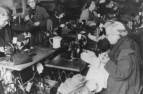 Forced laborers at work in a tailor's workshop. Theresienstadt ghetto, Czechoslovakia, between 1941 and 1945.