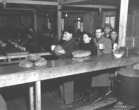 Jewish displaced persons receive food at the United Nations Relief and Rehabilitation Administration (UNRRA) Bindermichl displaced persons camp in the US zone. Linz, Austria, date uncertain.