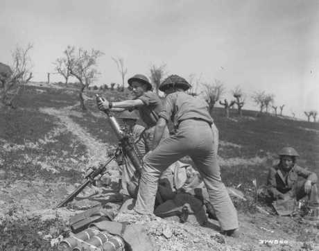 The 3-inch-mortar crew of the British army's Jewish Brigade Group, composed of volunteers from Palestine, fires on German positions during the final Allied offensive in Italy, March 30, 1945.