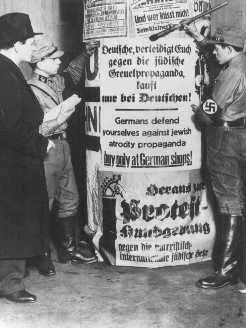 SA men post signs demanding that Germans boycott Jewish-owned businesses. Berlin, Germany, April 1, 1933.