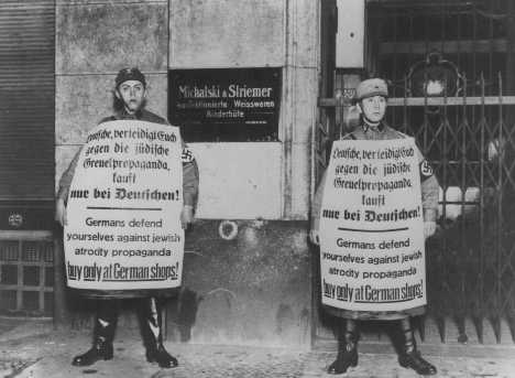 SA men picket Jewish-owned business during the boycott. Berlin, Germany, April 1, 1933.