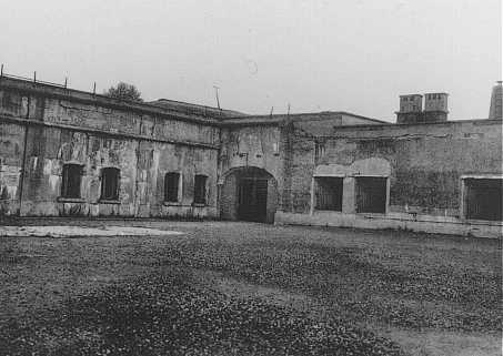 View of the courtyard in the Breendonk fortress prison where prisoners lined up for roll call. Breendonk, Belgium, postwar.