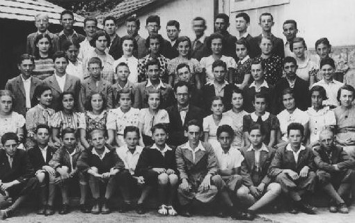 Group portrait of students and teachers at the Hebrew gymnasium in Munkacs. 1936-1937.