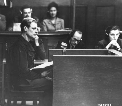 """Dr. Hans Hilmar Staudte, a former """"race examiner,"""" testifies as a defense witness at the RuSHA Trial. January 29, 1948."""