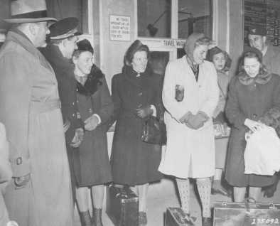Four Polish women arrive at the Nuremberg train station to serve as prosecution witnesses at the Doctors Trial. From left to right are Jadwiga Dzido, Maria Broel-Plater, Maria Kusmierczuk, and Wladislawa Karolewska. December 15, 1946.